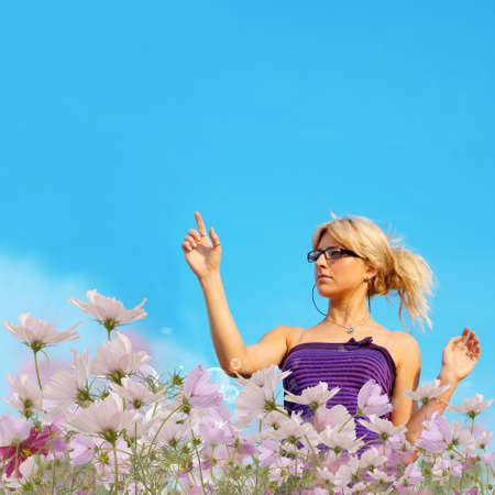 The young woman upon flowers summer meadow photo