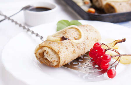 The fried pancakes with meat and baked vegetable photo
