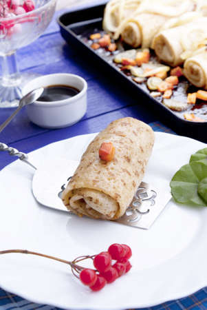 Appetizing baked pancakes with meat  photo