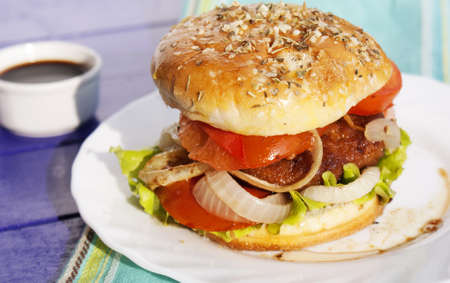 Burger with meat and baked vegetables photo