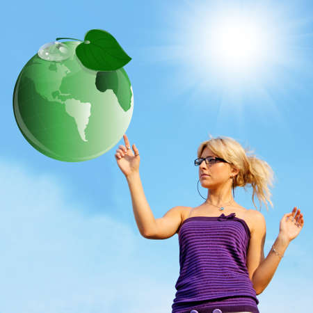 Ecology concept Green planet and young woman photo