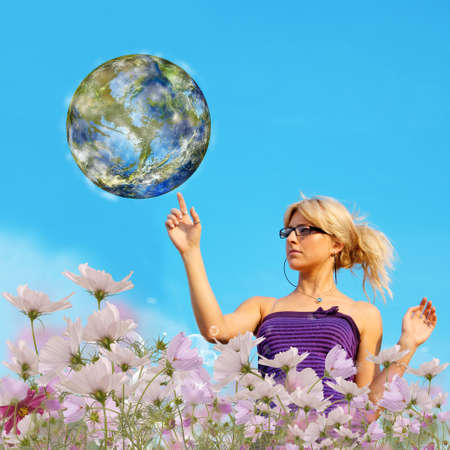 Beautiful young female and planet Earth Ecology concept photo