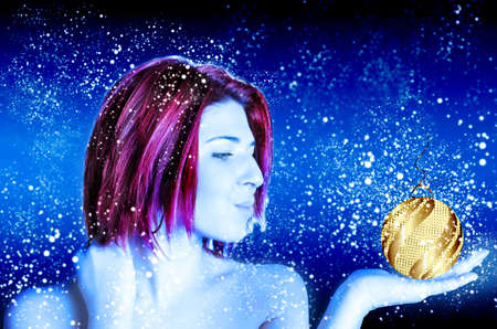 Beautiful January lady with purple hair on abstract blue with white snow flying photo