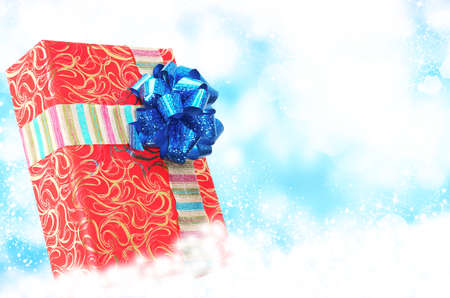 Christmas Surprise Red Box Gift on the snow background  photo