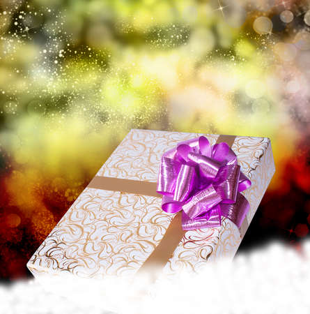 New Year Holiday Christmas Gift box on a snow photo