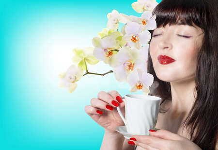 Japanese Beautiful Girl with a cup of green tea buds of orchids Best tradition Tea photo