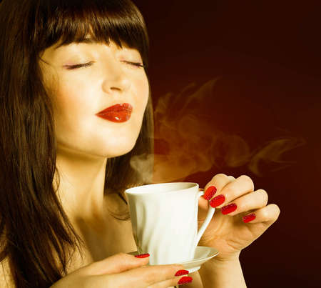 Beautiful Girl drinks aromatic Coffee photo