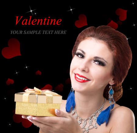Beauty Young Beautiful Girl with Golden Gift Box for Valentine Day  photo