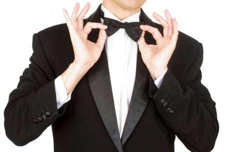 Portrait the man in a classical tuxedo on an white   Standard-Bild