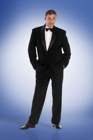 dinner wear: Elegant Men in Classic Tuxedo Stock Photo