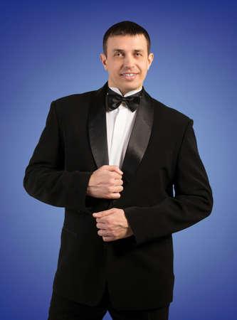 Elegant Man in Tuxedo  Fashion Portrait photo