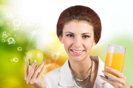 Woman Doctor with Juice Orange Glass and Fresh Green Apple on summer abstract sunny background photo