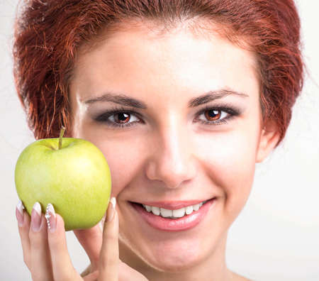Face young Girl with White Smile healthy Teeth and Fresh Green Apple photo
