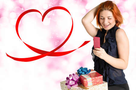 Happy Girl with Gift box talking on the phone Valentine Day photo