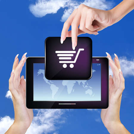 Digital Tablet in woman Hands on sky blue background E-commerce Internet photo