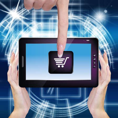 Computing Digital Tablet in Woman Hands E-commerce E-Shopping Season Discount photo