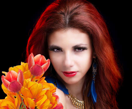 Beauty Woman with Spring Flower bouquet photo