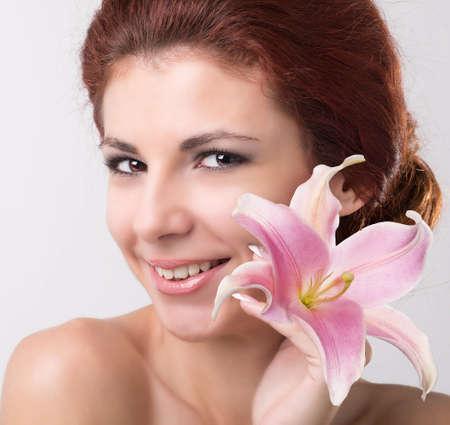 Beauty Portrait  Beautiful Spa Woman Touching her Face   photo
