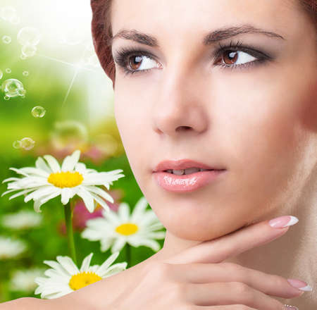 Beauty Young Girl over nature green background Skincare Face photo