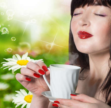 Coffee  Beautiful Girl Drinking Tea over green nature background photo