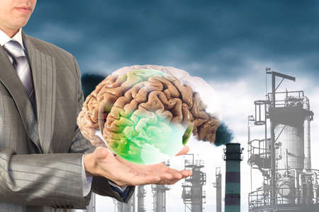 brain damage: The damage from industrial emissions for the brain people Stock Photo