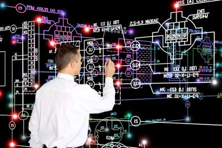 informational: E-designing computer engineering technology.Working Engineer Stock Photo