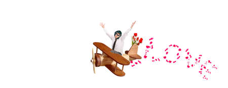 A man in love a pilot flies on a toy wooden plane to congratulate your favorite on the holiday photo