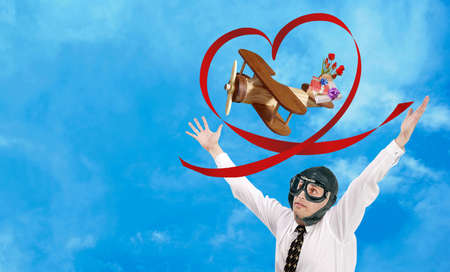 A toy wooden plane flies to congratulate on the holiday beloved. Loving man aviator photo