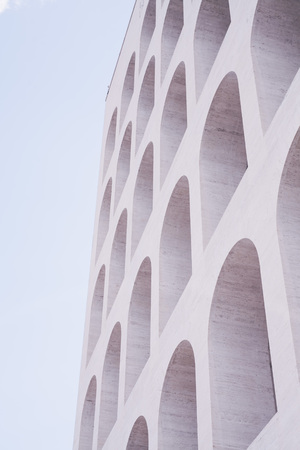 wholes in modern building with arches in Rome