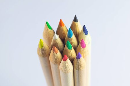 Group of ten colored pencils together made of wood