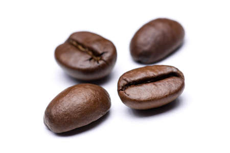 large bean: Coffee beans on a white background Stock Photo