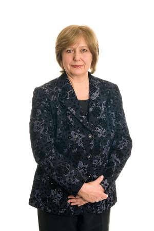 Een oudere vrouw glimlach op een witte achtergrond, geïsoleerd Stockfoto