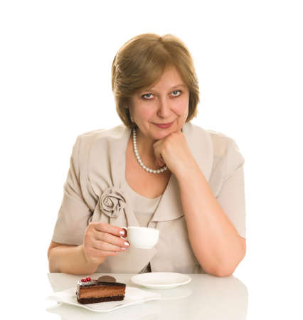 Old woman drinks coffee, isolated on white background photo