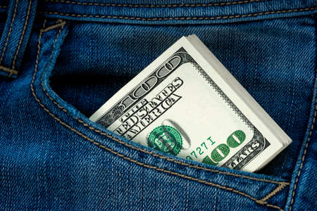 American dollars in a jeans pocket photo