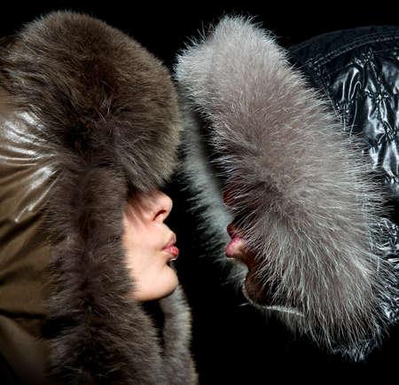 fur hood: Kiss in the winter of men and women in fur hoods
