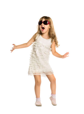 The little girl fun dancing in the glasses, isolated Standard-Bild