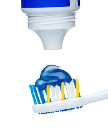 Toothpaste on blue toothbrush photo