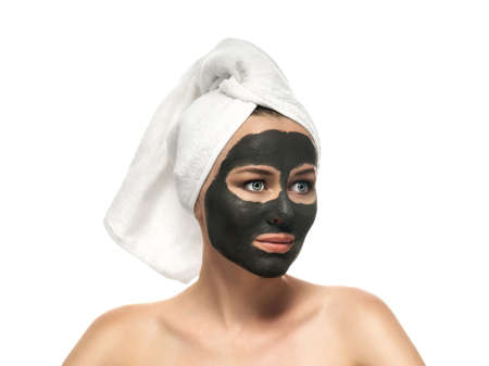 Woman receiving a mud mask  photo