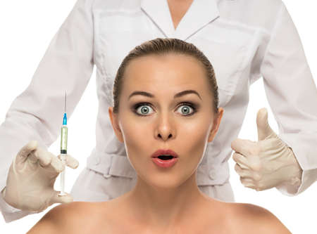 Beautiful woman face,beautician hands with syringe photo