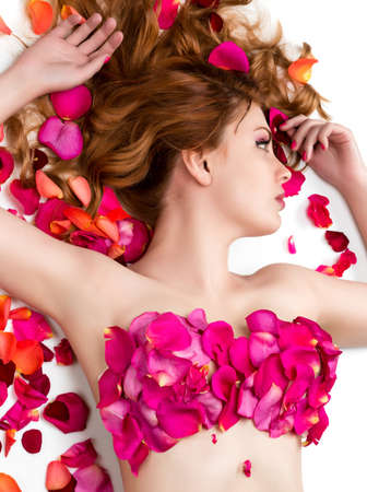 Female waxing armpit in a beauty salon  Ideal smooth clear skin  Beautiful woman lying in rose petals  Depilation  Epilation photo