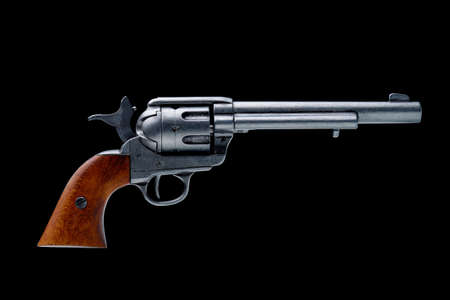 revolver pistol isolated on a black background photo
