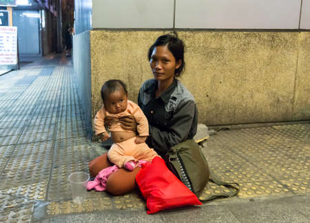 Homeless woman with child