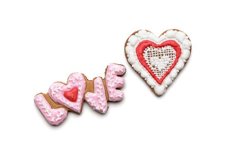 Cookies with the text of love and red heart on Valentine s Day photo