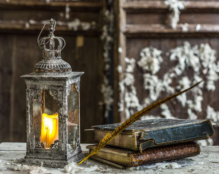 Vintage old lamp for the candle on wooden table photo