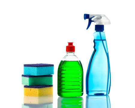 Plastic bottles of cleaning products and sponges   Isolated on white background