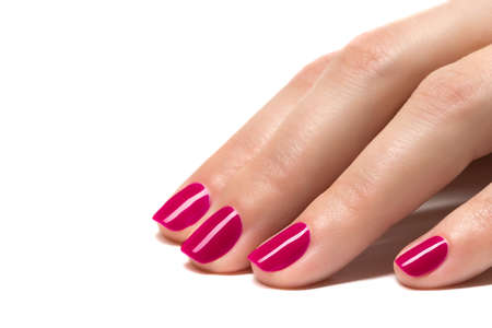 salon: Woman hands with manicured red nails closeup  Skin and nail care