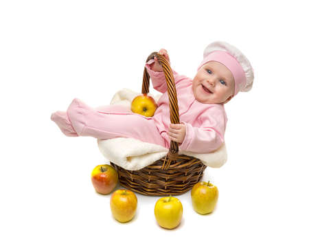 Beautiful little baby girl in the basket on white background photo