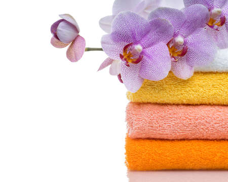 convolute: colorful towels and flower isolated on white Stock Photo