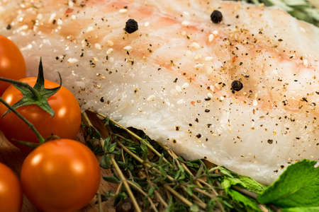 barramundi: Fillet of fresh raw fish with herbs and spices Stock Photo