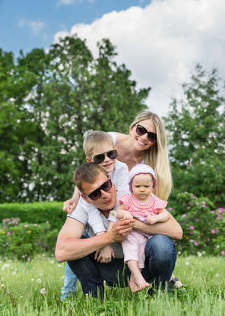 Portrait Of Happy Family In Garden photo